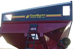 """Auger is visible from the tractor cab through the """"visibility"""" cut out of the tank."""
