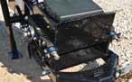 Spring loaded adjustment maintains belt tension